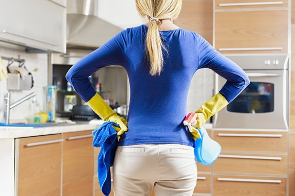 Woman attempting DIY mold remediation
